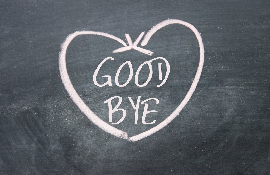 chalkboard with pink chalk heart reads goodbye